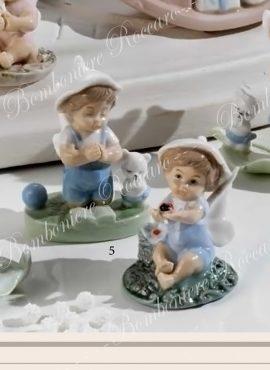 Angioletto porcellana celeste con giochi