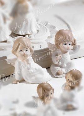 Angioletto porcellana seduto